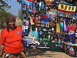 Mapula embroiderer holding hanging