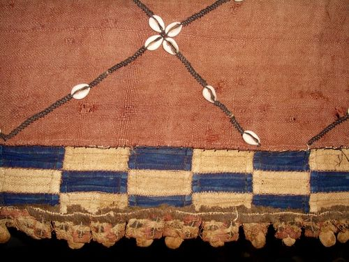 Antique African fabric, cowrie shells,indigo, raffia