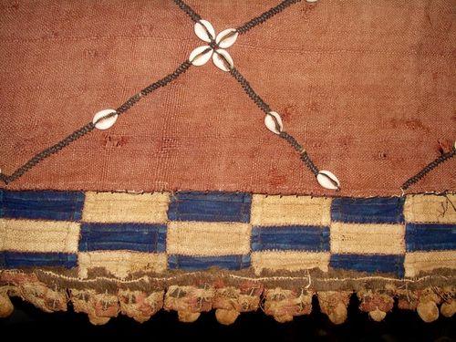 Antique African fabric, cowrie shells,indigo, raffia